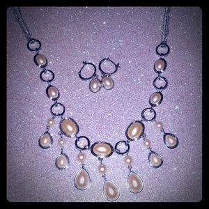 Set of matching pearl type earrings and necklace